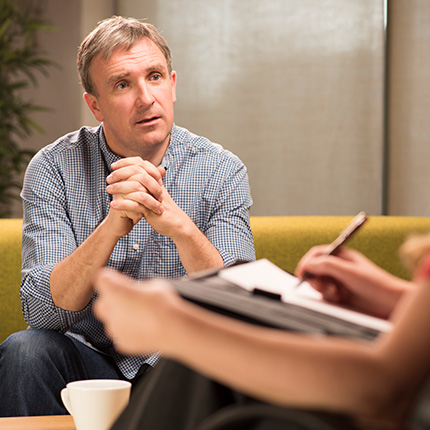 Middle-aged white man speaking with psychologist