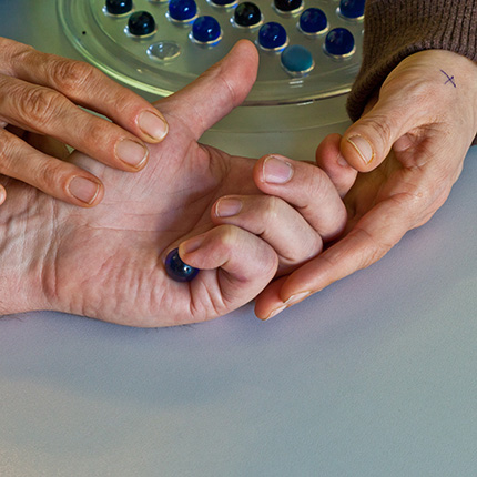 Therapist hands working on senior woman manipulation habilities