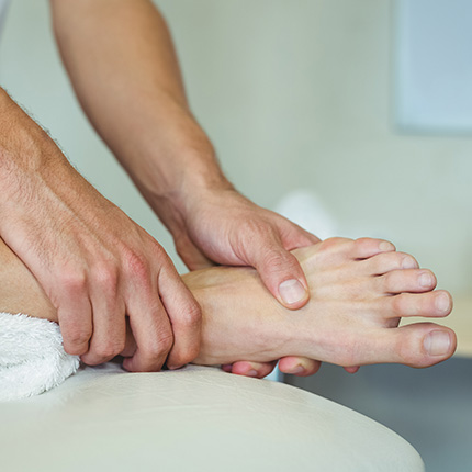 Doctor examining ankle
