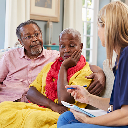 Concerned african-american couple speaking with therapist